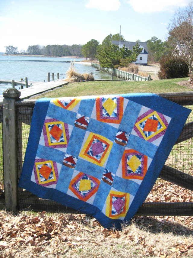 Windblown Quilt over Fence