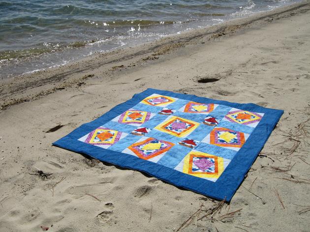 Windblown quilt on beach